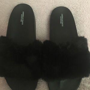 American Eagle black faux furry slides